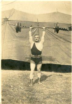 Strong man Joe Lambert at Miller Bros. Show, 1923