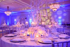 A winter wedding with elegant silver details upon a blanket of snow-white decor is the most romantic theme for a winter wonderland wedding.