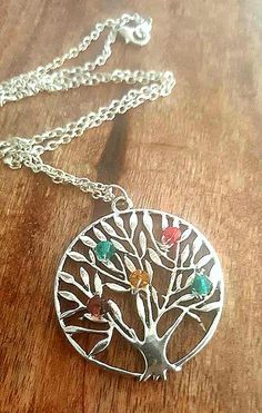 This beautiful birth stone necklace personalized necklace features a silver tone family tree of life pendant. The metal tree is adorned with sparkly glass crystal beads in the family stone colors of your choice. This makes a beautiful mothers gift, grandmothers, etc. Birth stone jewelry is not only popular, but its a gift that will be treasured forever. The chain is 18 long and can be made shorter or longer at your request. The pendant is 1.5 in diameter. This handmade necklace will be…