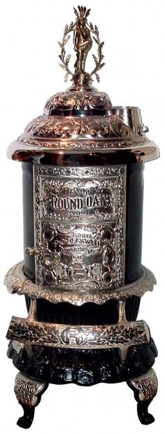 ROUND OAK Parlor Stove, model D-18 (1900-1905), ornate cast iron w/nickel-plated trim, with Doe-Wah-Jack Full Figure Finial