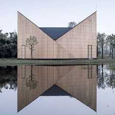 Here's another beautiful chapel from our archive – featuring a distinctive V-shaped roof made from vertical lengths of timber by AZL Architects. See more projects like this on dezeen.com/tag/chapels #architecture #chapel #timer #China Photograph by Yao Li.