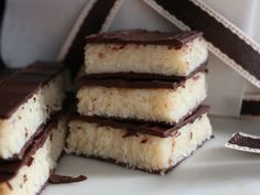 Turrón de Coco! Comida Cubana! A Christmas must! Creamy shredded coconut cooked down with condensed milk and brightened with orange zest and a few drops of vanilla. Plus chocolate!