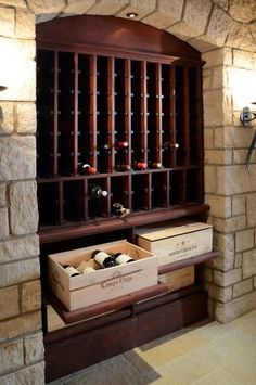 Wine room with pull-out drawers.  We need this in our place now!