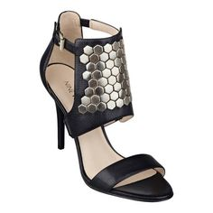 "Hexagonal studs craft the vamp of our Dawnonme open toe dress sandals. Adjustable ankle buckle closure. Leather upper.  Padded footbed for all-day comfort. Leather upper. Man-made lining and sole. Imported. 3 3/4"" high heels.  As seen in the March/April issue of Weight Watchers magazine."