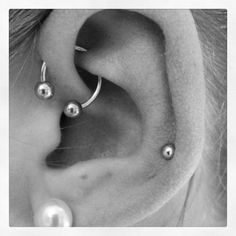 I wanted the industrial, but apparently have weird shaped ears, so I got the UFO piercing. I LOVE it :) <3 ... Uploaded with Pinterest Android app. Get it here: http://bit.ly/w38r4m
