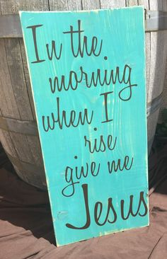 This rustic wooden sign measures about 12x24 inches and is painted a distressed turquoise. This rustic country home wall hanging says In the