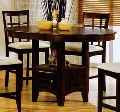 LOVE this pub style table!! too bad i don't have room for one right now :(