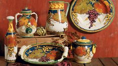 Beautifully  painted with grapes and grape leaves and an intricate pattern around the rim