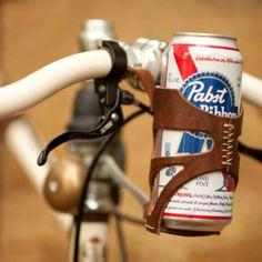 Hipster beer holder. Genius. http://findgoodstoday.com/bikes