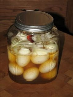PICKLED EGGS 1 dozen JUMBO eggs 1 1/2 cups vinegar 1/2 cup water 1/2 cup sugar 1/2 teaspoon salt 1 teaspoon ground cloves 1 onion, sliced into thin rings 1 whole dried chile pepper