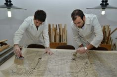 Trabajos previos de conservación del fondo planimétrico de la compañía Enadimsa.