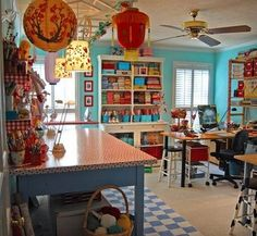 The beautiful studio. Love the checkerboard rug and different shades of blue/mint together with pops of red and yellow.
