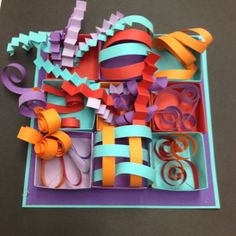 What a WONDERFUL table project for paper sculptures, this looks so put together --- Collaborative paper folding each student does a box