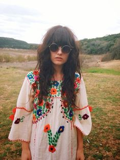 a colorful, light summer look -- long hair, neon pom poms reminiscent of the 1960 beatniks, not to mention those vintage styled sunnies