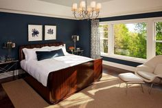 Martha O'Hara Interiors: Dark navy bedroom with nautical/coastal feel! Contemporary wooden sleigh style bed with ...
