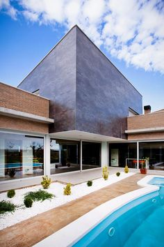 Amazing private house located in Lleida, Spain built with Oxido negro #City gris relieve and Escandinavia ceramic tile series.