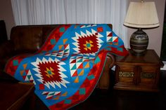 Navajo Throw, the colors are wonderfully matched. It is pieced from squares and HSTs.