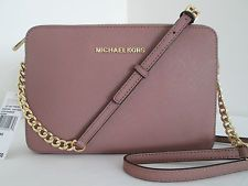 NWT Michael Kors Jet set Travel Dusty Rose Large Saffiano Leather Crossbody Bag.