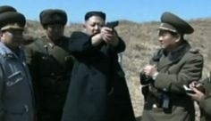 North Korea's leader Kim Young-un attended a military target shooting training. Surrounded by chief officers, he held a loaded gun that he swayed back and forth completely unconcerned with safety.