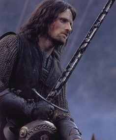 """""""Aragorn threw back his cloak. The elven-sheath glittered as he grasped it, and the bright blade of Andúril shone like a sudden flame as he swept it out. 'Elendil!' he cried. 'I am Aragorn, son of Arathorn, and am called Elessar, the Elfstone, Dúnadan, the heir of Isildur Elendil's son of Gondor."""""""