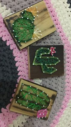 A DIY I just did, I took 3 small boards and nailed the nails on the board with the shape that I wanted (in that case it's cactus  ) , uses strings in colors of green,pink and yellow, and that's it!  You think I can sell that kind of stuff?