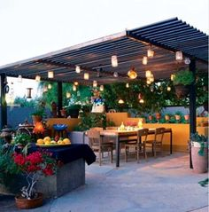 Backyard Patio with lanterns hanging from pergola...would be fun for evening entertaining