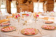 Gold and Pink table settings.  Pink Chevron Napkins. Gold Horseshoes. Champagne Centerpieces #duderanchwedding @Angie Ripley Rader