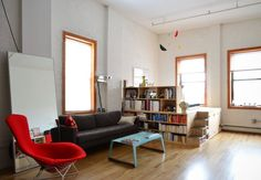 Name: Danny & Joni Location: Williamsburg, Brooklyn, New York Size: 690 square feet Years lived in: 3.5 years How do you make 690 square feet feel absolutely enormous? Add tall ceilings, lots and lots of windows, and some clever DIY storage solutions.