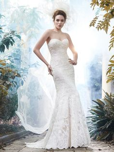 Maggie Sottero - FREDRICKA, The epitome of bridal bliss is found in this tulle A-line wedding dress