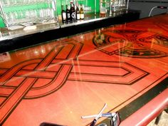 ... together. The bar top had a cool inlaid Celtic knot-type of design