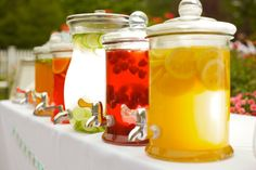 refreshers.  This is a nice setup for a garden wedding.  Punch, Iced tea, Lemonade, Water with lemon slices, blueberries, strawberries just to add a pretty touch.  Weddings do not have to have alcohol.