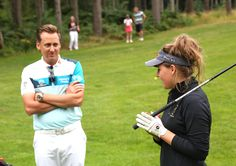 Ian Poulter chatting the one of the juniors at the Invitational on the golf course