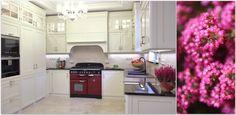 Nowoczesna, angielska kuchnia z białymi meblami kuchennymi do zabudowy. Biel, która zapanowała w pomieszczeniu została przebita ciemnymi blatami oraz ponadczasowym piekarnikiem.    Modern, english style, white kitchen with black worktops and special oven