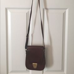 Selling this  Brown Leather Imprinted Floral Cross Body Bag in my Poshmark closet! My username is: saccardi. #shopmycloset #poshmark #fashion #shopping #style #forsale #Unknown #Handbags