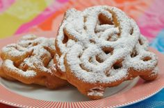 What's your favorite carnival food? Bet you said funnel cake! This funnel cake recipe tastes just like the kind you find at a summer fair - sweet warm bread, deep fried and sprinkled with lots of powdered sugar. No need to wait for the traveling circus, make this delicious, old-fashioned treat at home.