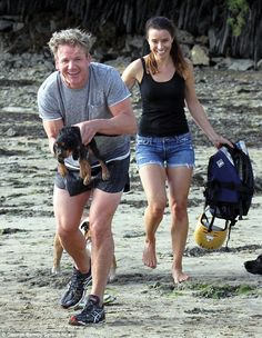 Puppy love! Gordon Ramsay happily doted on the family's new pet pooch Bruno on the beach in Cornwall earlier this week, while being joined by wife Tana and the rest of the brood