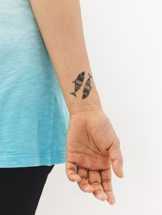 Pisces, this is your month! The Pisces Tattly temporary tattoo by Danielle Kroll.