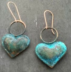 Pillow hearts. Blue patina over copper.