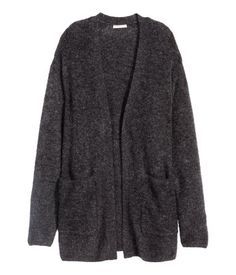 Oversized cardigan in a soft blend of wool and mohair with dropped shoulders and long sleeves. Front pockets and no buttons.