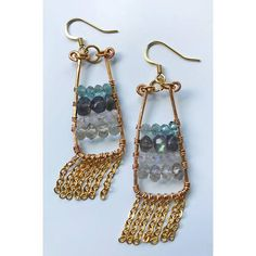 "These one of a kind eye catching modern boho ""abacus"" style earrings were made with blue flash labradorite beads, smokey quartz, blue green apatite and rainbow moonstone. Frames were hand forged with 24k gold plated copper jewelry and fish hook findings are 14k gold plated. These are"