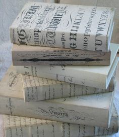 DIY bookcovers - buy some cheap hardbacks at estate sales and cover them with pretty paper or fabric for decor.