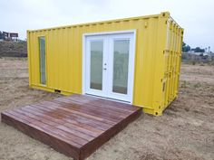 Excellent Storage Container Home Builder for Alternative House Design : Minimalist House Design Made Of Shipping Container With Yellow Paint Wall And A Simple Wooden Terrace Among The Desert Shipping Container Storage, Shipping Container Office, Shipping Container Home Designs, Storage Container Homes, Container House Design, Shipping Containers, Container Architecture, Container Buildings, Architecture Design