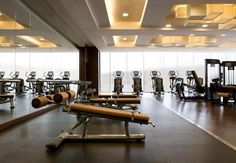Love the use of the tan leather / vinyl on the fitness equipment for a warmer, luxury feel.