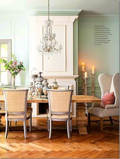 Cote De Texas~our trestle table & wing back chairs...love the collection of mercury glass on table. Inspiration!