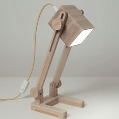 "Adjustable wooden desk lamp.Made of solid wood- beech. Covered with wax-oil. Height: 40cm/16"" Bulb: LED Textile cord: 2 m./6.6ft."