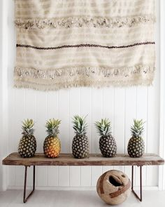 moroccan wedding blanket hung over a row of pineapples (!) in kara rosenlund's home, via @Remodelista