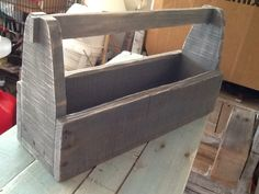 Vintage Toolbox made from reclaimed pallets. Note the pegged handle, just like a back in the day toolbox. Visit my FB page - AllPalletThings