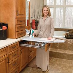 This ironing board folds in and out of a standard drawer. Perfect for a bathroom, laundry room, or walk-in closet!