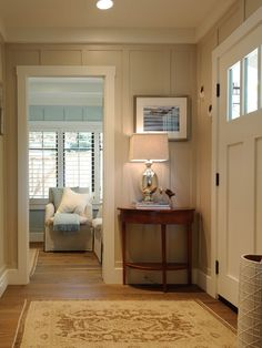 Painted paneling, warm wood floor, shutters