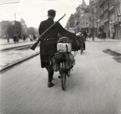 1943. Member of the Landwacht marches through the streets of Amsterdam. The Landwacht was founded in 1943 in support of the Dutch police. This organization had its roots in the NSB and was formed to protect high-ranking members of the NSB and NSB buildings. In reality it turned into a Waffen SS organization. The training of the Landwacht was conducted by the SS in SS-barracks and the members were dressed in SS uniforms. Photo Emmy Andriesse. #amsterdam #worldwar2 #landwacht